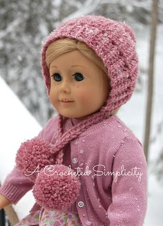 """Winter Poms"" 18″ Doll Hat This cute winter hat was designed for my daughter's dolls. She had asked for a snowsuit for them for Christmas and needed a hat to coordinate. So what d…"