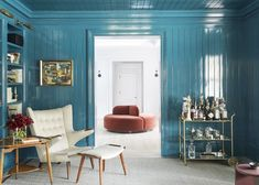 Did you know choosing feng shui colors for an office depends on its cardinal direction? An expert explains how to find your ideal feng shui office colors. Wood Paneling Makeover, Painting Wood Paneling, Paneling Ideas, Paint Over Wood Paneling, Wood Paneling Decor, Painted Paneling Walls, Planked Walls, Blue Painted Walls, Teal Walls