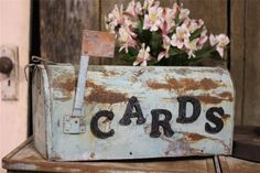 I love the idea of a well loved vintage metal mail box for cards.