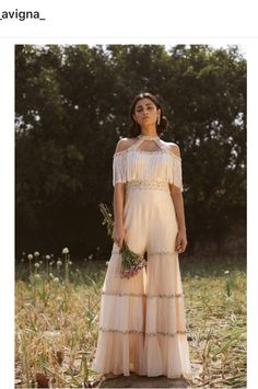 Breaking the monotony of conventional silhouettes, Avigna designs head-turner wth this tassel accented tired jumpsuit. Whatsapp us now for personal shopping experience! Indian Bridal Fashion, Indian Fashion Dresses, Dress Indian Style, Indian Designer Outfits, Indian Outfits, Stylish Dress Designs, Stylish Dresses, Western Dresses For Women, Sharara Designs
