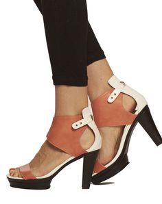 """This gorgeous ankle-hugging sandal offers a modern look and a steady step. Featuring gold-peg adjustable closure and 1"""" covered platform, Emerson gives you all"""