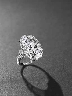 An important diamond ring, by Graff.Photo Christie's Image Ltd 2013    Set with an oval-shaped diamond, weighing approximately 26.24 carats, to the pear-shaped diamond shoulders, weighing approximately 1.06 and 1.04 carats, mounted in platinum,ring size adjustable 5¼ to 6¾.