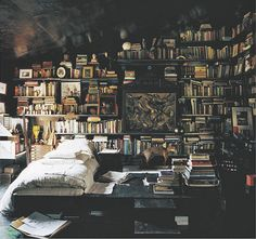 dark wood and the books, although we move too much to live like this #bedroom #books
