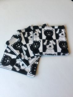 These adorable black and white coasters depicting cats and dogs are the perfect coasters to protect your pet-loving homes surfaces from rings and stains. Picture YOUR glass of wine resting upon this fun product and make them pop in your own home today!  Item Details: * Two sets in stock * 1 set = 4 coasters * 100% cotton * Lined with 100% cotton batting * Backed with solid black 100% cotton * Pre-washed and pre-shrunk * Machine washable (cold water and laid flat to dry) * 4.5 x 4.5 *Appr...