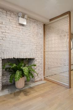 framed macrame screen for dividing spaces and to add a boho flavor
