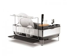 The simplehuman steel frame dishrack has a solid stainless steel frame that matches the aesthetic of modern upscale kitchen appliances. It has a swivel spout that pivots so you can drain water directly into the sink and an anti-residue coating that prevents residue buildup and water spots. The wine glass holder hangs up to 4 wine glasses - even those extra-large Bordeaux glasses. A fingerprint-proof coating helps protect against smudges, and a natural bamboo knife block is gentle on sharp…
