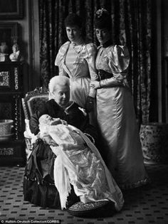 Queen Victoria holds her great grandson Prince Edward, the future King Edward VIII, at his christening. With her is her daughter-in-law Alexandra, Princess of Wales and Princess Alexandra's daughter-in-law Princess Mary, the mother of the young prince, 1894