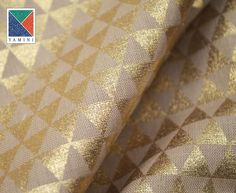 A gorgeous table cloth with gold geometric print