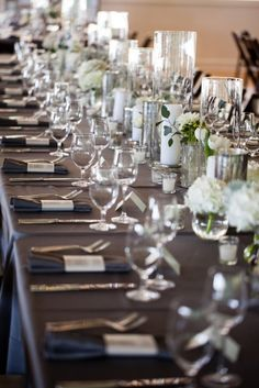Sweetgrass Social wedding at Alhambra Hall. Erika & Sergio. Table with dark linens and white flowers with candles.