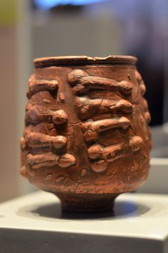 Roman vase with phallic design at Colchester Castle Museum, made especially for libations in honor of Priapus, god of fertility.
