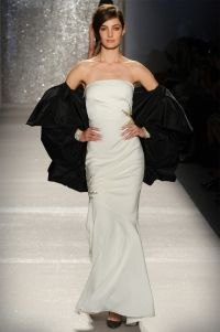 Coat  - Black silk taffeta cocoon coat .  Gown -  Ivory stretch faille strapless gown with sunburst beaded motifs