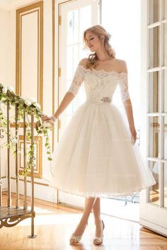 1512f50177a Classy off-the-shoulder tea-length white wedding dress with lace quarter  length sleeves  Featured Dress  Justin Alexander needs to be floor length