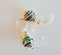 https://flic.kr/p/yZDfQY | caged tahitian pearl earrings | www.designsbydiane.info/#!product/prd1/4324884185/tahitia...