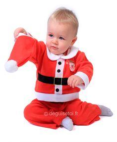 Disfraz de bebé Noel para niño: Disfraz de bebé Noel para niño compuesto por tres elementos. Un pantalón elástico en la cintura. Un top en forma de chaqueta con cinturón, cuello, botones falsos y...