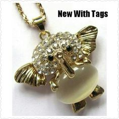 $8 Stunning Elephant Pendant Necklace NEW WITH TAGS PRICE FIRM   Material:Zinc Alloy  Gold Tone Elephant With Rhinestones in Head  *2 Black Gem Eyes  *Opal Stone Stomach *HOLLOW BACK(SEEN IN PIC 2) *CHAIN IS ABOUT 15 INCHES *Lobster Clasp Jewelry Necklaces