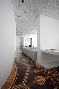 Marcel Wanders stained hardwood floor design