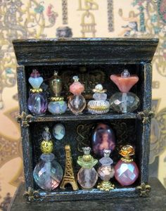 Marie Antoinette Perfume Cupboard OOAK dollhouse miniature in one inch. I love that beads were used to make these lovely little bottles! They don't have to just be perfume bottles, they can also hold Fairy Dust! Miniature Furniture, Doll Furniture, Dollhouse Furniture, Miniature Crafts, Miniature Dolls, Miniature Bottles, Diy Dollhouse, Dollhouse Miniatures, Bottles And Jars