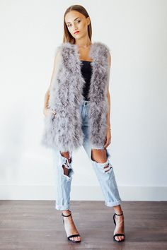 Long grey ostrich feather gilet With pockets Silk lined These are made to order…