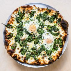 RECIPE: Breakfast Pizza: Sausage, Eggs, Spinach & Cream (from Pizza Camp by Joe Beddia)Great for breakfast, but to be enjoyed anytime. The first time I had this pizza was the first time I let my dough. Breakfast Pizza, Savory Breakfast, Breakfast Bowls, Breakfast Sandwiches, Egg Sandwiches, Breakfast Ideas, Breakfast Time, Best Brunch Recipes, Mexican Breakfast Recipes