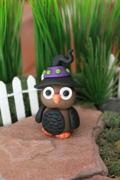 This little owl is all ready for Halloween! Check out his witchs hat and black feathers - he dyed them especially for the occasion ;) He stands approximately 2 tall and has great detailing. Hes a great addition to your Halloween miniature gardens. Or put him in an ordinary houseplant to add a little whimsy. The options are endless. Hell be sure to get smiles no matter where he ends up :) *******************  Each figurine is made entirely by me from start to finish. They are sculpted…