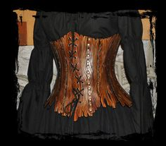 Bark patterned corset. I think I'd like my bark pattern to be more subtle and natural looking, but this is still a nice example. For mine, I would go with straight lacing and no rivets.