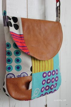 I like the leather mixed with the bright patterns.