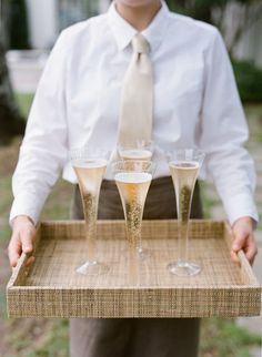 Clink! Champagne is served. Photography : Lucy Cuneo Photography Read More on SMP: http://www.stylemepretty.com/living/2016/08/16/all-roads-lead-to-charming-with-this-stunning-southern-garden-party/