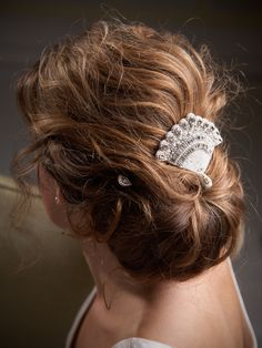 Simple, elegant hairstyle with a pretty comb