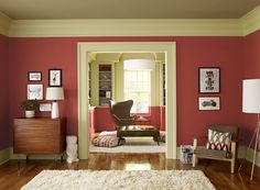 """Modern living room in Benjamin Moore """"Crisp Coral"""" color scheme (red parrot on the walls, guilford green on trip, meditation on ceiling)."""