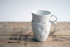 Cute white ceramic cup, handmade and decorated with pillow effect on Etsy, $19.00