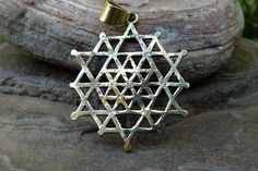 """Merkaba Pendant made from High Quality Nickel Free Brass    Double sided (see photos)  One side is hand hammered, the other regular    Measurements: 1.8 inches / 4.5 centimeters     Ancient mystical traditions (such as the Kabbalah), and contemporary channelled information (such as the  """"Keys of Enoch"""") speak of the Merkaba as a vehicle for inter-dimensional travel. As we approach the moment of the Shift, formerly secret teachings about the Merkaba are coming to light.    The merkaba is…"""