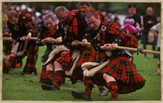 A team of kilted competitors use all their strength in the tug-o-war during Highland Games celebrations