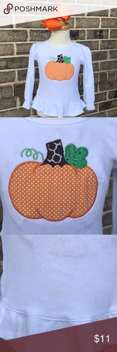 🧡🧡🎃🎃cute Fall shirt with pumpkin applique🧡🧡 🧡🎃🎃cute fall shirt with applique. Used in excellent condition. Size 2T. Ruffled shirt and sleeves. You will love this. If you like this, please visit my Etsy page also. It is KaceysKreationsShop. I do Appliqués and monogramming. I have a lot of other kind Do items there. Let me know if you have any questions. 🧡🧡 Shirts & Tops Tees - Long Sleeve
