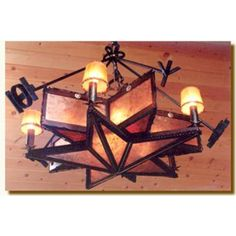 Star Chandelier  Let history into your home with this creative chandelier. Large chain, hand forged from square stock extends to five historic brands from Texas and the Southwest states. These brands suspend the chandelier whose shape commemorated the Texas ranger. The two dimensional stars are finely detailed, one ...