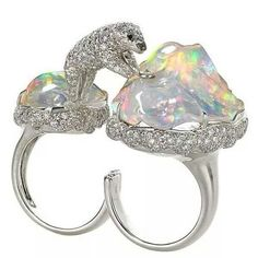 This 18K white gold ring featuring a Diamond (4.12 ctw.) polar bear jumping between Opal icebergs (33.77 ctw.) from Gwennie by Michael John of Michael John Jewelry received 3rd Place in the Evening Wear division. #AGTA #AGTASpectrum15 #MichaelJohnJewelry