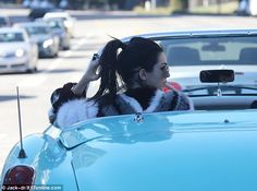 Cruise control: Kendall Jenner was spotted zipping through Beverly Hills in her powder blue 1961 Corvette on Tuesday, which - like her - deftly commanded attention