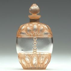 "R. LALIQUE Perfume bottle for Jay Thorpe, ""Jaytho,"" clear and frosted with sepia patina, c. 1928."