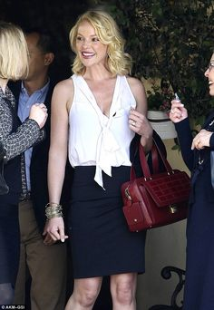 Katherine Heigl gave a huge grin as she stood with her mother and friend outside the restaurant where they had dined, April 2013.