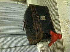 Heavy black metal box of unknown origin. A French Apartment...