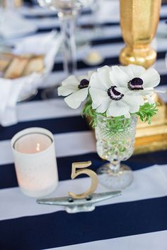 Simple gold table numbers | @lauren_fair | Brides.com