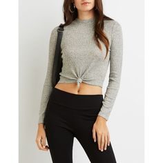 Charlotte Russe Ribbed Mock Neck Knotted Crop Top (£12) ❤ liked on Polyvore featuring tops, sweaters, ribbed sweater, ribbed crop top, charlotte russe sweaters, cropped sweater and long sleeve crop top
