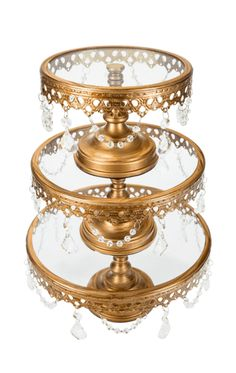 - Features 3 individual cake stands with transparent glass surfaces and a sturdy weighted base - Frame is draped with beautiful glass crystal pendants - The 3 different sizes range from: Dessert Stand, Cupcake Stands, Dessert Tables, Crystal Cake Stand, Cake Pedestal, Dessert Aux Fruits, Wedding Cake Stands, Tiered Stand, Plate Stands