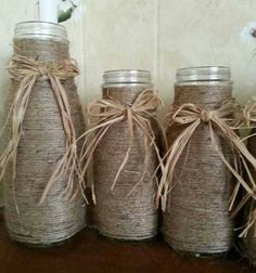 Starbucks frappe bottles look like old milk bottles. Twine wrapped with bow. Rustic wedding