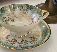 Antique Tea Cup and Saucer, Tea Cup Set, Gold Aqua Blue Tea Cup, Germany, Hand Painted Porcelain, Mothers Day Gift for Mom  ~ Marked on back RRW Bavaria Made in Germany.  ~ Well preserved - Free of cracks, chips and crazing. Any white spots on china are reflections.  ~ Have questions or want more photos? I'll be happy to provide them.  ~ Careful packing and fast shipping at Vintage Tea Cup Shop.  To receive our new listings: Click Favorite shop box at top left of page.  SHOP VINTAGE TEACUPS…