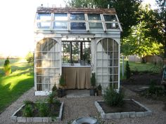 Tucked inside our garden...just steps away from my studio sits a tiny garden folly   Tinker House        Constructed from reclaimed doors,...