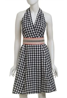 DISCO DYNASTY DRESS Nanette Lepore This gingham wrap front dress features an elastic belt and buttons at waist. Flare skirt. Racerback. Rounded hem is slightly longer at back.