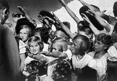 Nazi Germany, Children greeting Adolf Hitler, 1935.