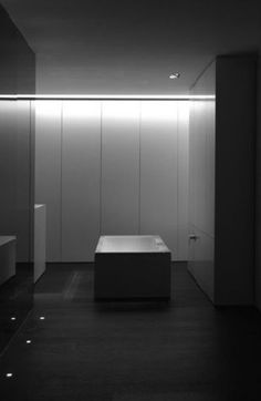 Beautiful indirect lighting, minimal bathroom by architect Filip Deslee