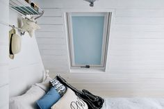 Skylight blinds for roof windows from Bloc Blinds. Available in plain and patterned blackout fabric. Motorised options too.