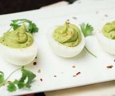 Healthier deviled eggs with a flavorful guacamole kick. The perfect protein-packed snack or party food.